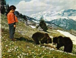Boy with Bear Cubs in Cavria